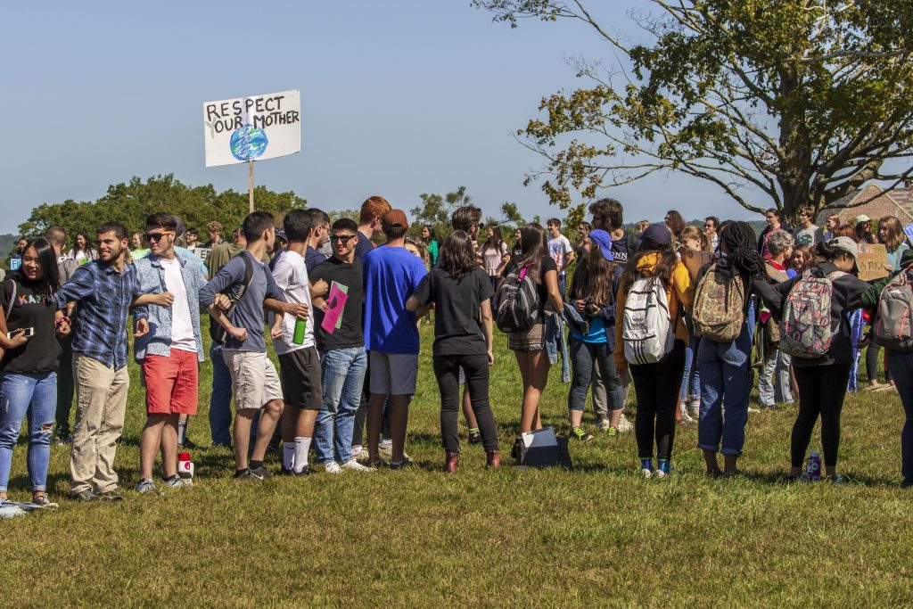 Students gather on the Great Lawn to form an hour glass during the Climate Strike on Sept. 20, 2019. The Connecticut Institute for Resilience and Climate Adaptation is hosting a series of webinars this summer to examine climate change and policy from a multitude of angles.
