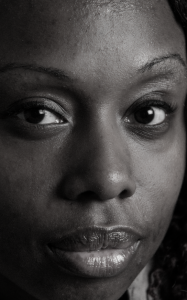 A closeup portrait of a Black woman's face, from a new exhibition by photographer Joe Standart.