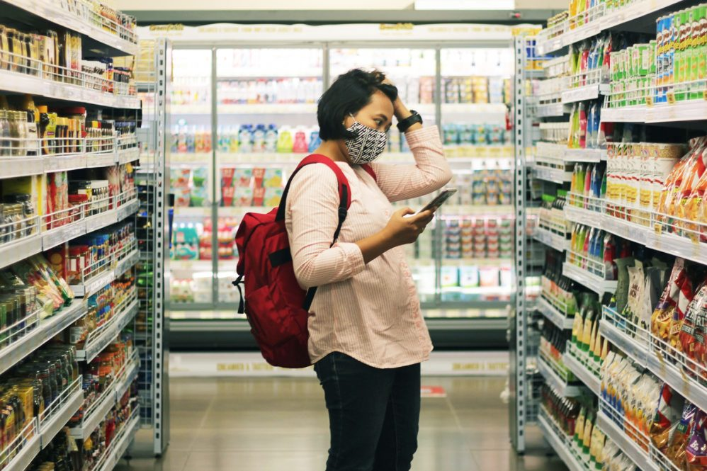 woman standing in a grocery store isle