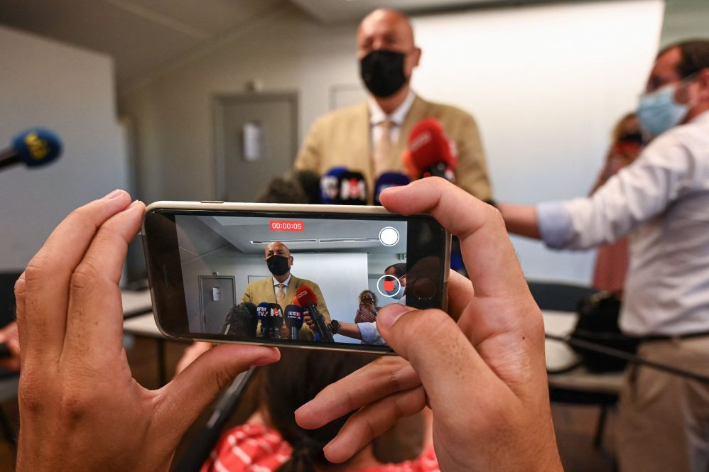 A photo of a news conference being livestreamed via iPhone. As the tools and delivery platforms of journalism have changed, fundamental skills remain critical, says UConn journalism department head Marie Shanahan.