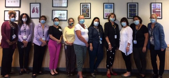 Group shot of UConn Health clinical social workers, in masks