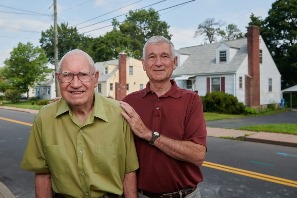 Fredrick Ware, left, and his son, David Ware JD '76, LLM '20 stand in front of his home in Manchester on July 17, 2021.