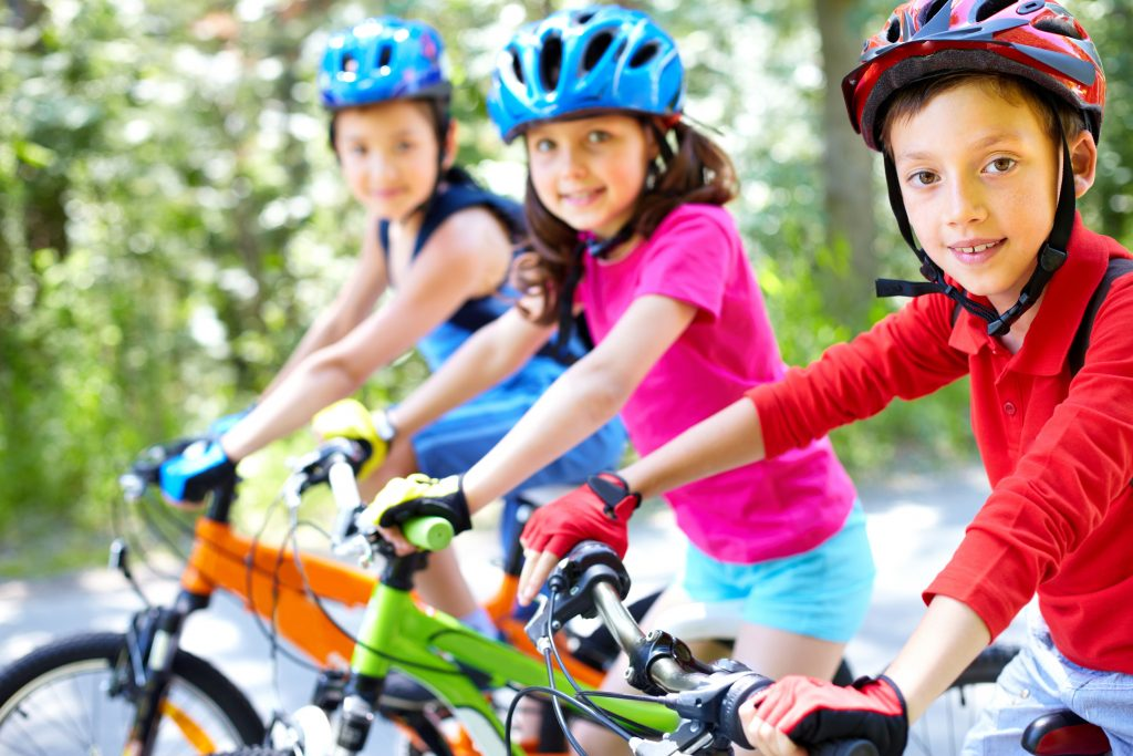 kids on bikes riding on a trail