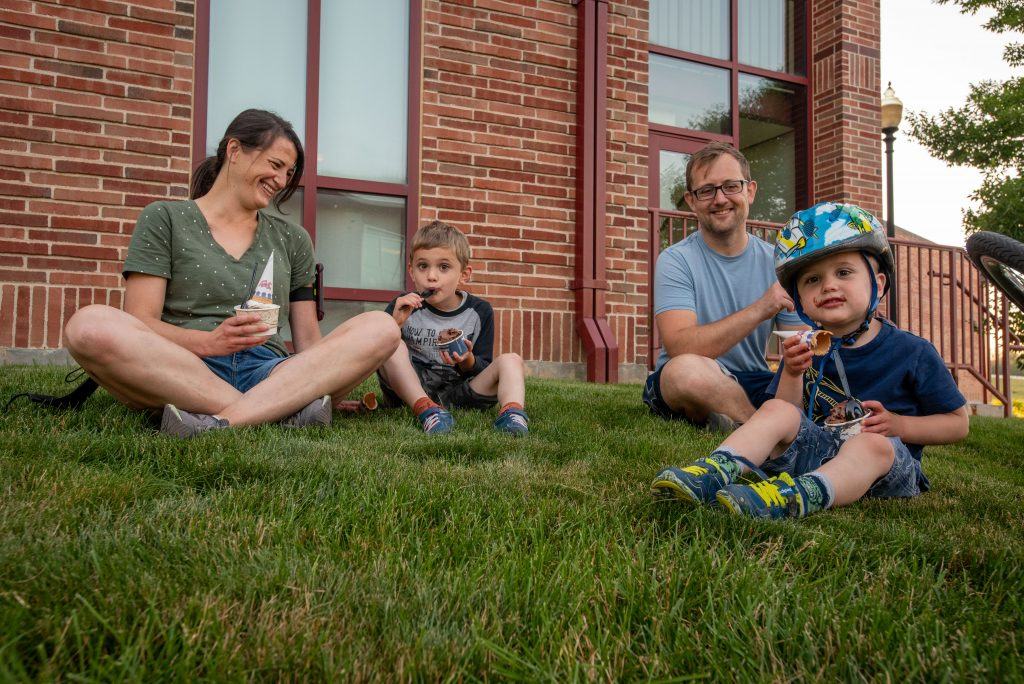 Assistant Professor Ryan Cooper and his family at the UConn Dairy Bar on June 17, 2021. (Sean Flynn/UConn Photo)