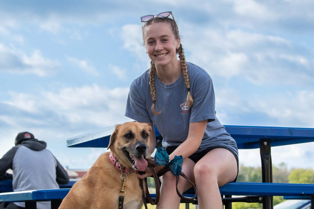 Katie Germond and her dog Molly patiently wait for their ice-cream at the UConn Dairy Bar ion June 12, 2021. (Sean Flynn/UConn Photo)