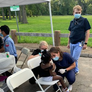 patient care at outdoor community clinic