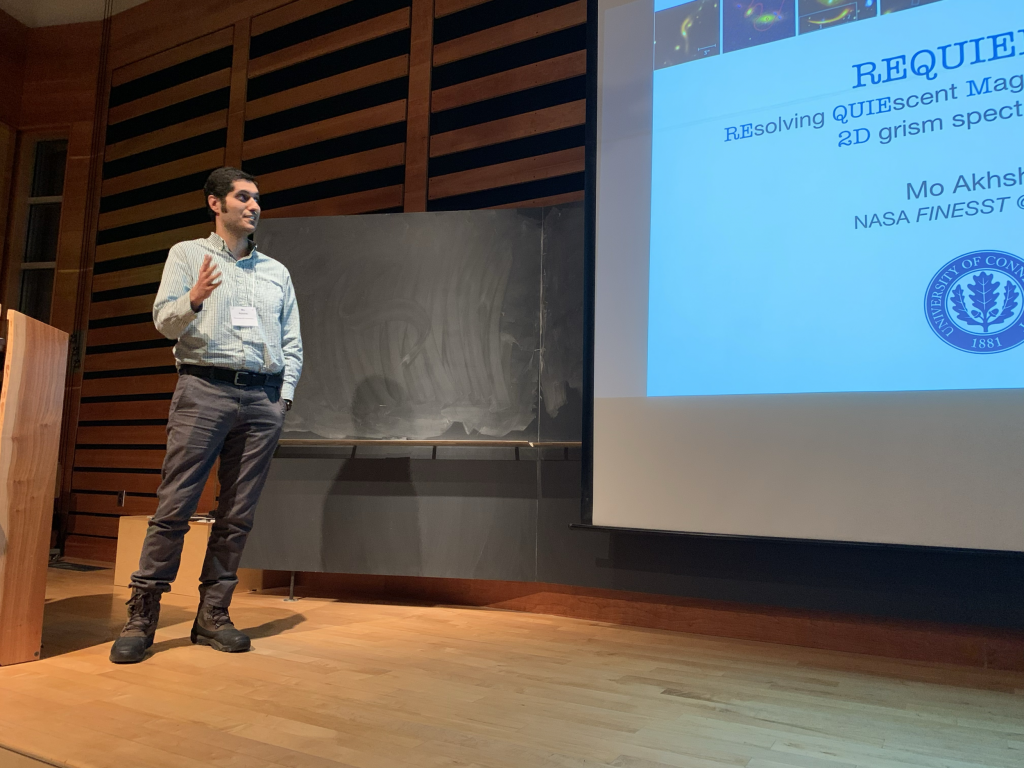 Mo giving a presentation at the Aspen Center for Physics in February 2020.