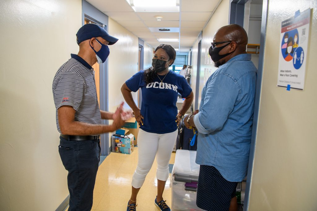 Andrew Agwunobi, interim president, visits students and their families at the Towers Residence Halls on Aug. 27, 2021. (Peter Morenus/UConn Photo)