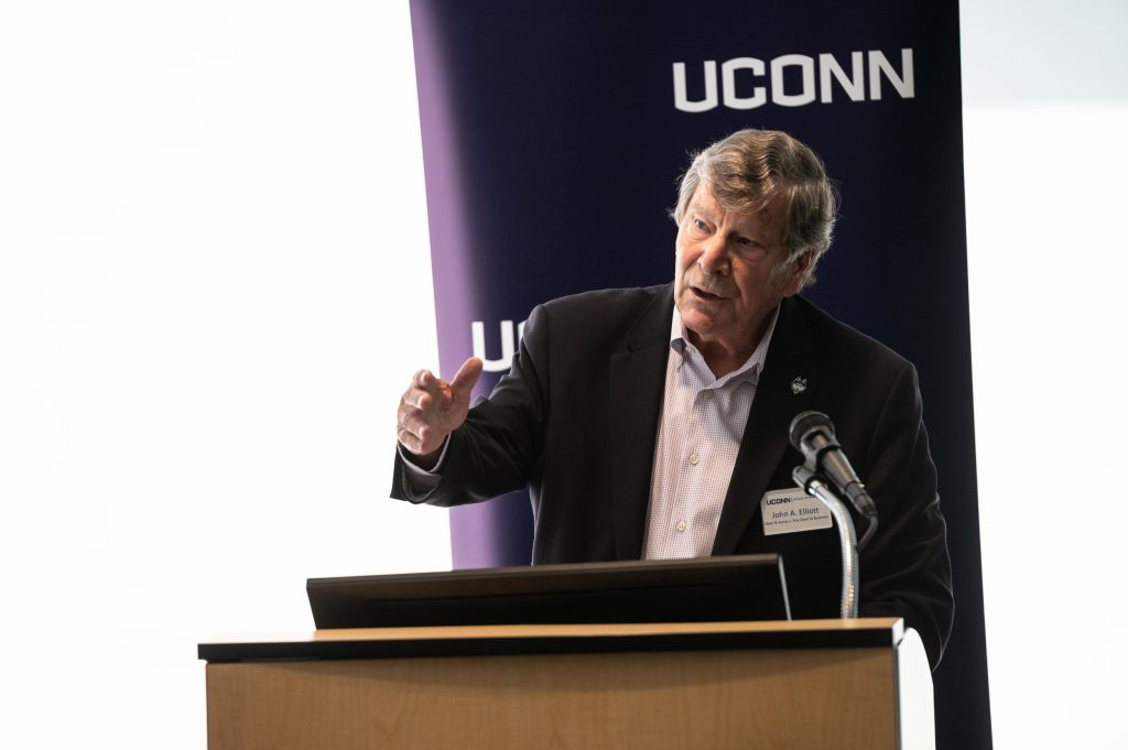 UConn School of Business Dean John Elliott speaking at a news conference in Hartford announcing a $2 million federal grant to assist minority-owned small businesses in Connecticut.
