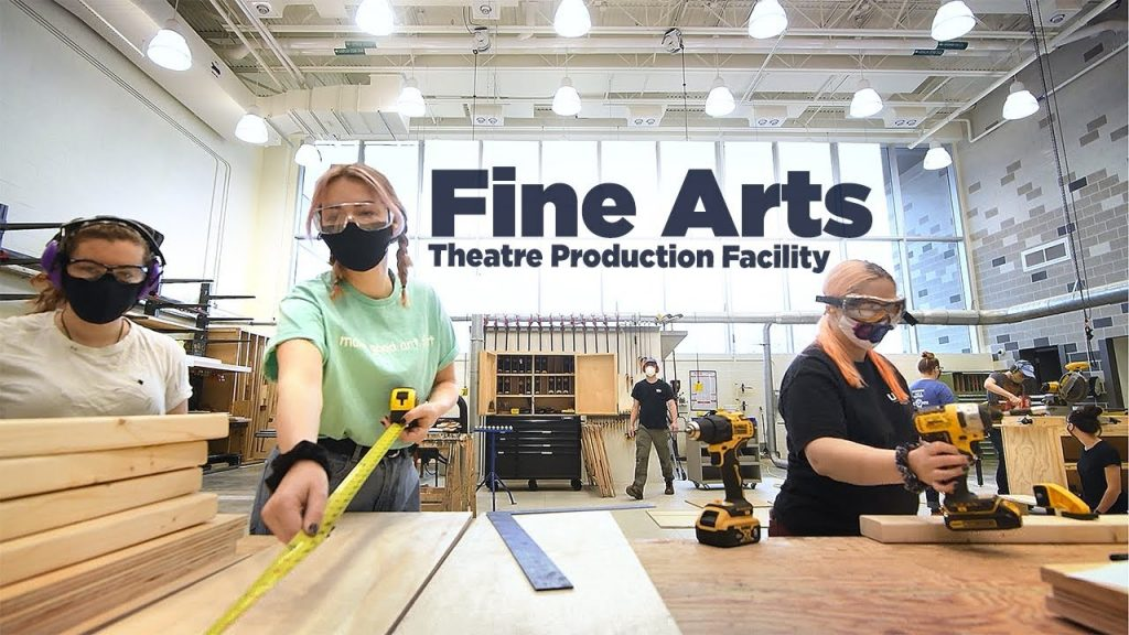 students working on building theatre sets in new production facility