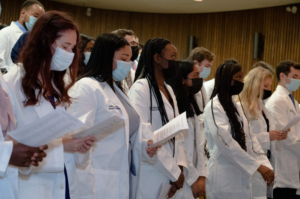 UConn School of Medicine and UConn School of Dental Medicine students receiving their white coats in a ceremony on Aug. 20.