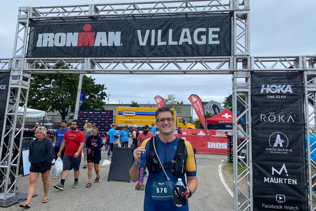 Dr. Joel Ferreria with his finisher medal at the iron man finish line