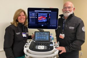 Two vascular technologists with advanced ultrasound machine