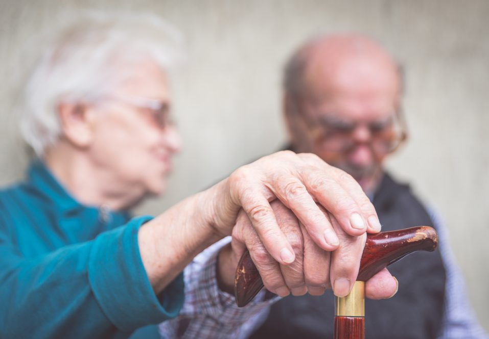 An older couple holding hands. Research at UConn enabled by a new endowment is aimed at alleviating illnesses common to the aging process.