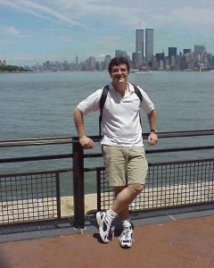 Dirk Stanley with the Twin Towers in the background June 2001