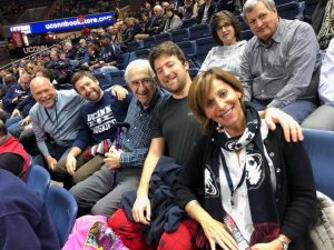 Michael (far left) and Shari Cantor (far right) and family members taking in a UConn basketball game. The Cantors have made a major donation to support UConn students.