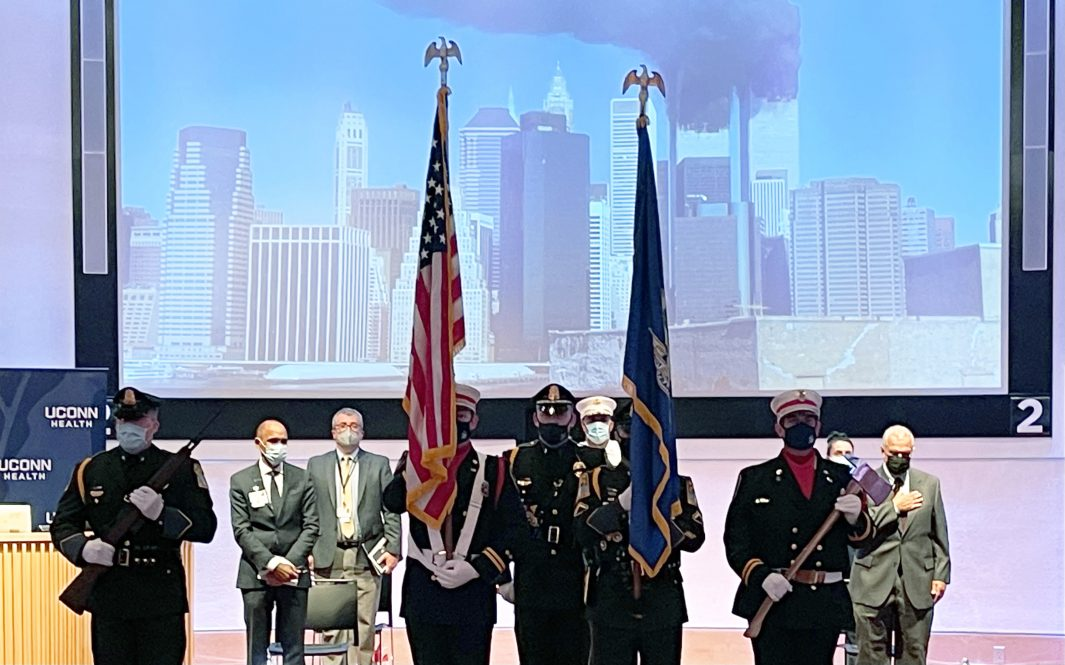The color guard in front of 9/11 image.