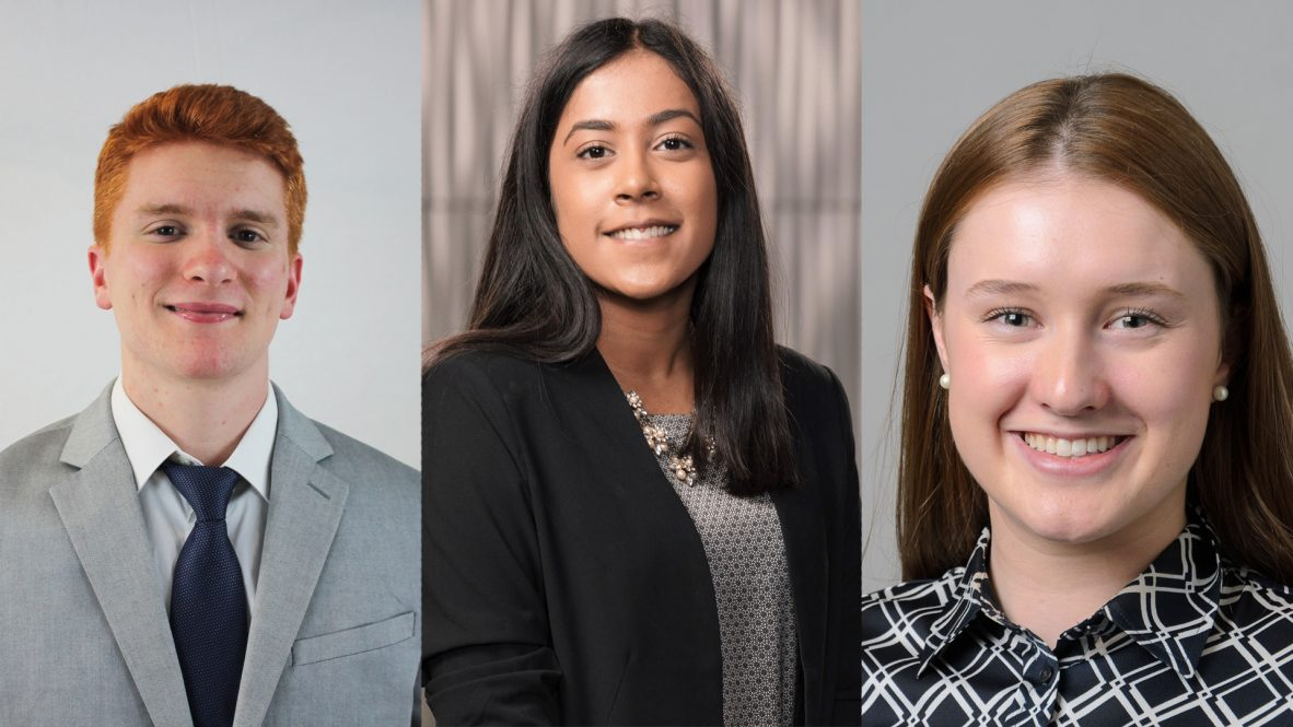 Three students selected as Actuaries of Tomorrow pose for their portraits.
