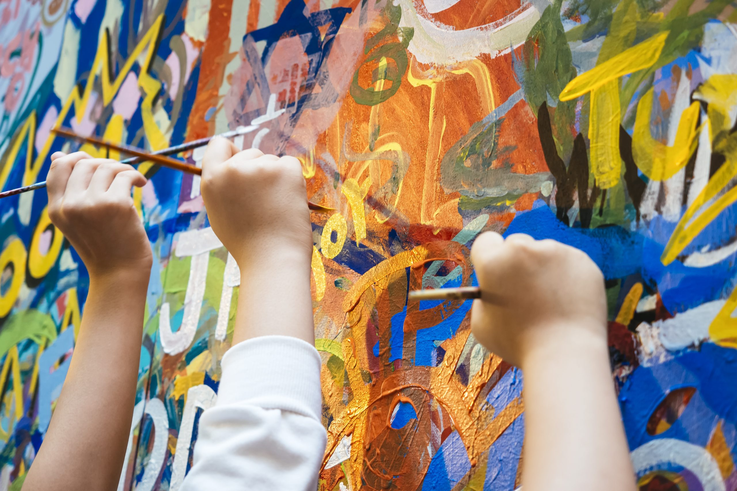 Kids hands with Colourful Paint Background. UConn Psychologist James Kaufman explains how to nurture creativity in kids.
