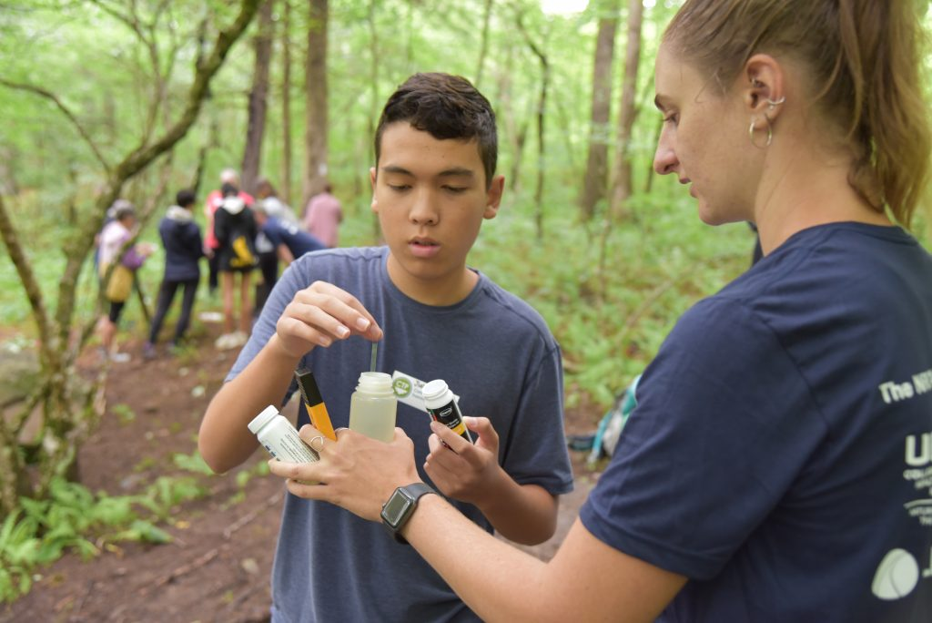 Student and instructor in the forest