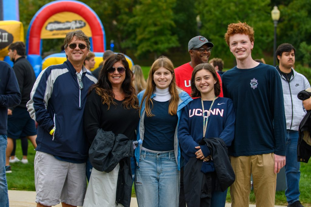 Ava Buckmir '25 (CLAS) with family at the Homecoming Carnival during Family Weekend on Oct. 10, 2021.
