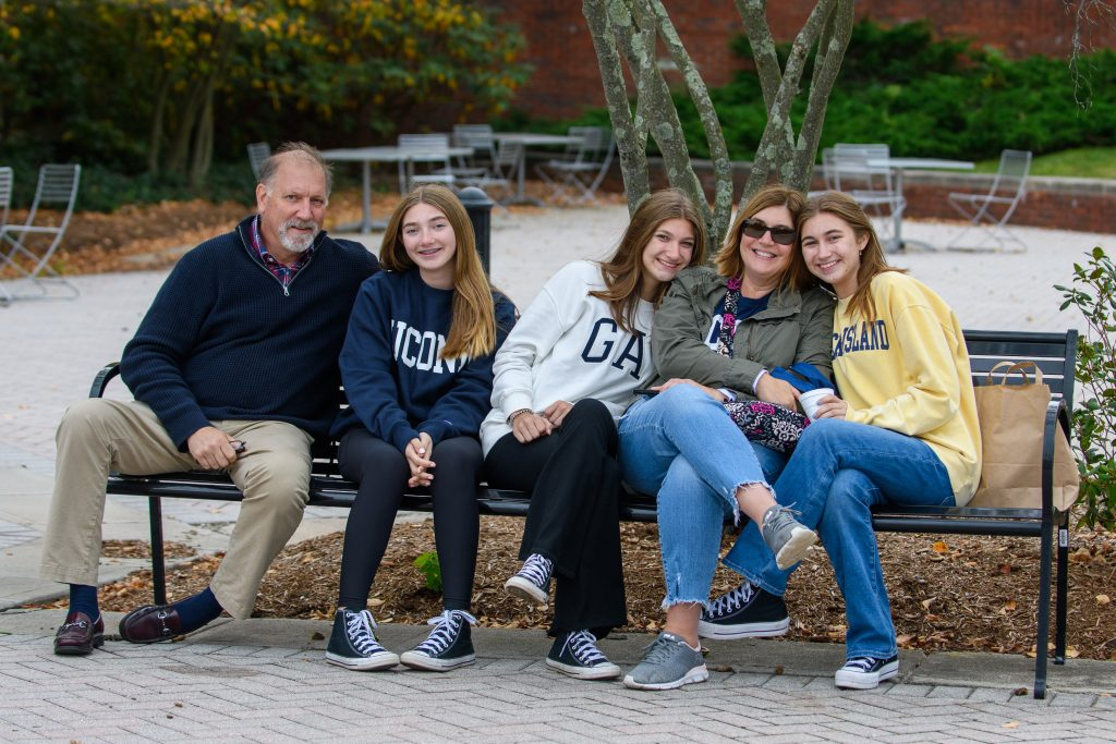 Phoebe Bergstraser '25 (NUR) and her family attend the Homecoming Carnival during Family Weekend on Oct. 10, 2021. (Kayla Simon/UConn Photo)