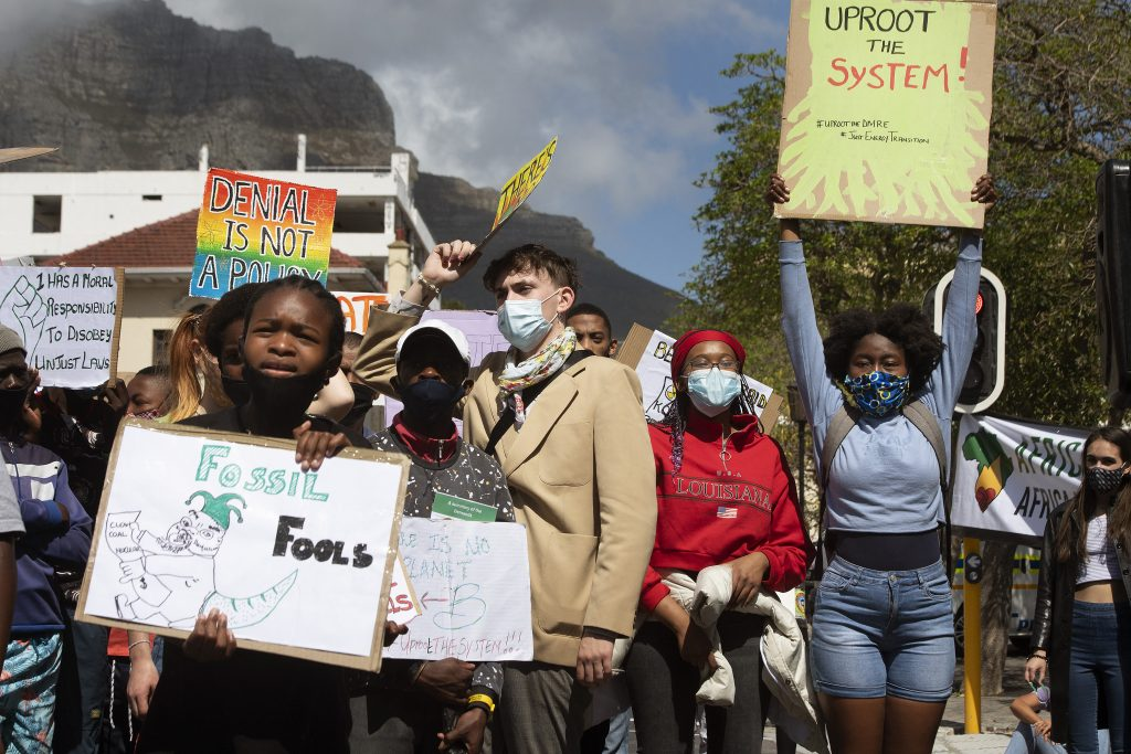 Hundreds of people take part in a Global Climate Strike protest on September 24, 2021, in Cape Town, South Africa, demonstrating against the causes of global climate change, and in particular, the South African Department of Mineral Resources and Energy (DMRE).